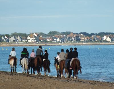 Horse riding on a Normandy beach
